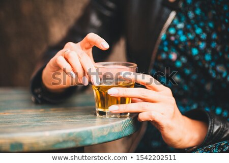 woman with glass of whisky Stock photo © ssuaphoto