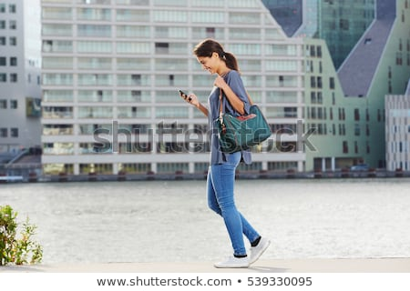 Nő mobiltelefon sétál utca fiatal nő belváros Stock fotó © adamr