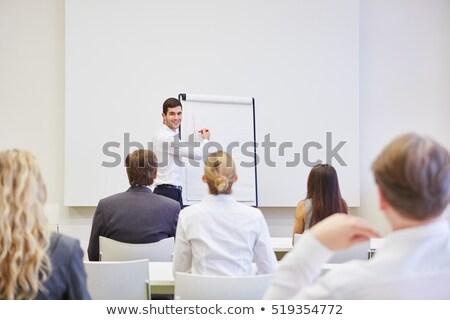 Empresário flipchart negócio mulher caneta estudante Foto stock © photography33