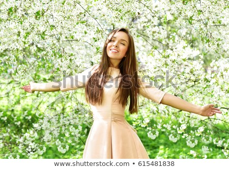 Gorgeous brunette with flower. Stock photo © lithian