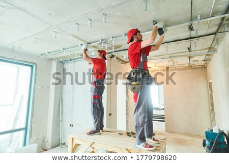 Gipsplaten niveau controleren werk Stockfoto © lisafx