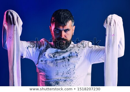 Stock photo: Man in a straitjacket