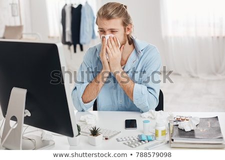 sick man surrounded by pills stock photo © involvedchannel