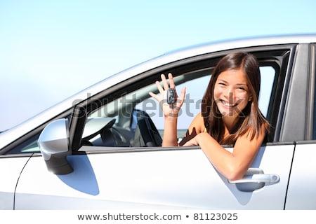 Stockfoto: Happy Mixed Race Woman In Car Holding Keys