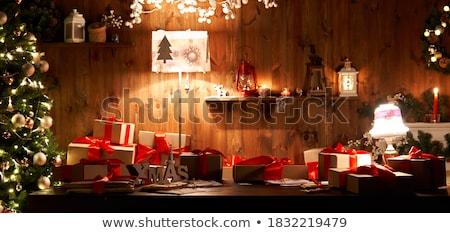 santa claus in dark with candle Stock photo © carlodapino