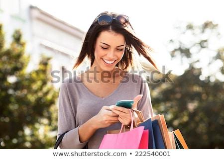 aantrekkelijk · jonge · klant · portret · kleurrijk · zakken - stockfoto © lithian