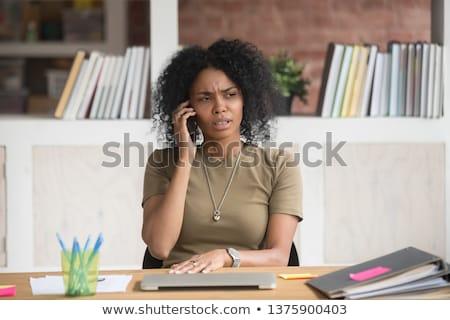 Zangado empresária falante telefone escritório sorrir Foto stock © wavebreak_media