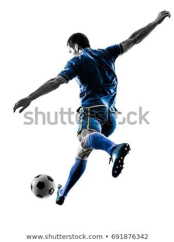 Soccer player kicking Stock photo © kalozzolak