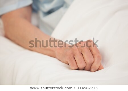 Elderly arm outstretched in hospital bed Stock photo © wavebreak_media