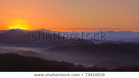 early morning sunrise over blue ridge mountains stock photo © alex_grichenko