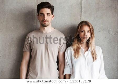 Divat pár áll szemtől szembe fiatal nő Stock fotó © feedough