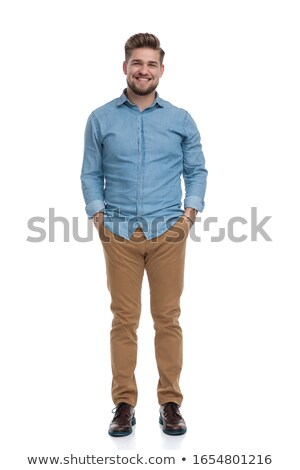 casual man laughing with both hands in pockets Stock photo © feedough