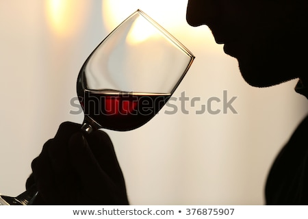 thirsty man drinking out of a wine glass Stock photo © meinzahn
