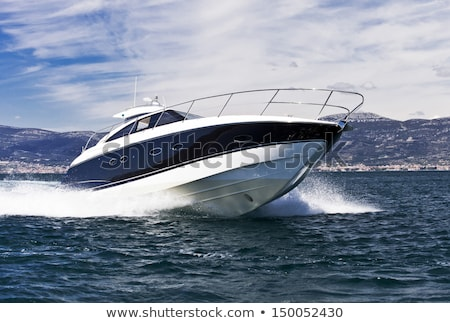 Motor boat driving fast on the blue sea Stock photo © Mps197