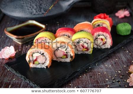 szusi · tányér · fekete · kavicsok · hal · háttér - stock fotó © bmonteny