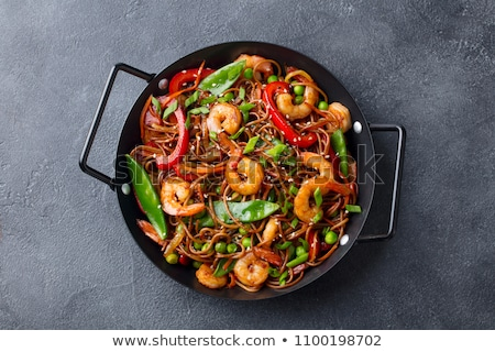 fried chili pepper and vegetable on a wok pan Stock photo © keko64