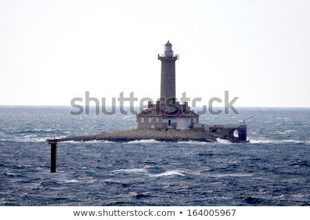 lighthouse in stormy sea porer rt kamenjak istra croatia stock photo © fesus