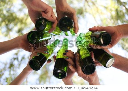 Adolescente gruppo bere alcol insieme Foto d'archivio © HighwayStarz