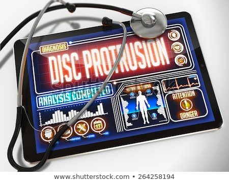 disc protrusion on the display of medical tablet stock photo © tashatuvango