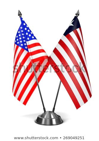 USA and Liberia - Miniature Flags. Stock photo © tashatuvango