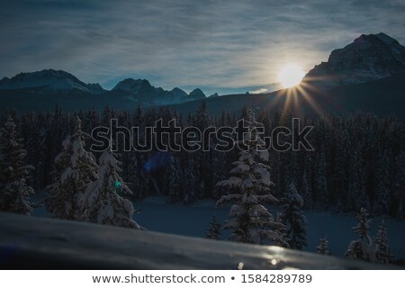 Colorful Alpine scenery with sun setting down Stock photo © tommyandone