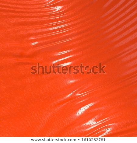 Kırmızı lateks güzel genç esmer elbise Stok fotoğraf © disorderly