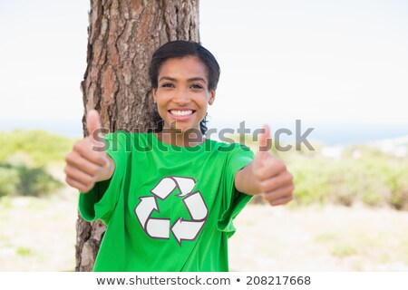pretty environmental activist looking up at tree stock photo © wavebreak_media