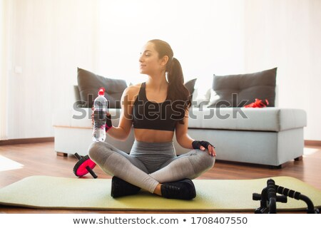 sporty young woman doing abdominal exercises stock photo © deandrobot