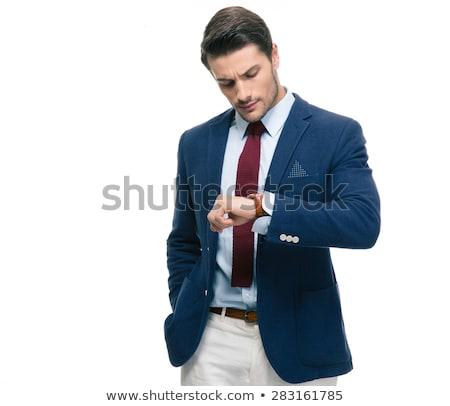 Bello imprenditore guardando isolato bianco Foto d'archivio © deandrobot