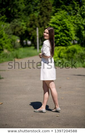 Attractive bride Girl model with long brown hair style wearing i Stock photo © Victoria_Andreas