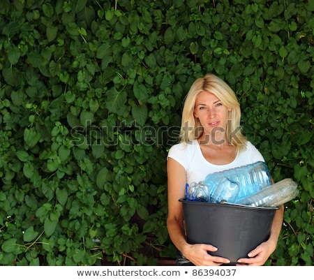 portrait of woman carrying recycling bin stock photo © highwaystarz