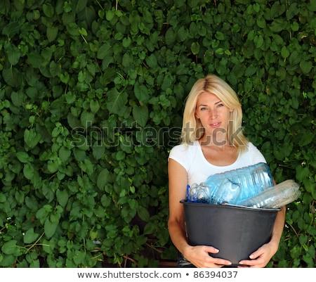 Portrait Of Woman Carrying Recycling Bin Stock photo © HighwayStarz