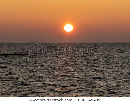 Napfelkelte üdülőhely város égbolt nap természet Stock fotó © amok