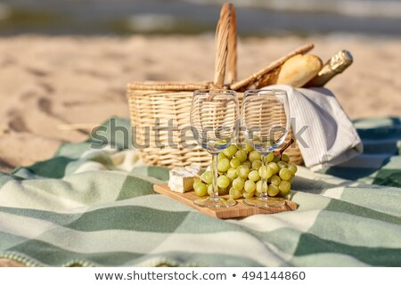 Picnic Basket, Wine Bottle and Empty Glasses Stock photo © feverpitch