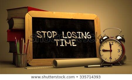 stop wasting time   motivational quote on chalkboard stock photo © tashatuvango
