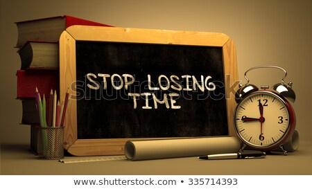Stop Wasting Time - Motivational Quote on Chalkboard. Stock photo © tashatuvango
