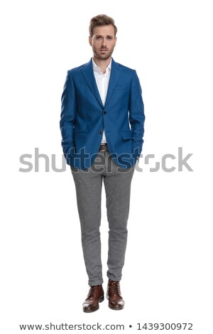 Attractive young business man holding both hands in his pocket. Stock photo © feedough
