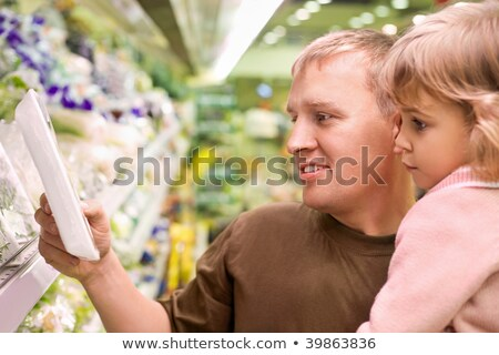 Smiling young man with little girl buy parsley in supermarket Stock photo © Paha_L