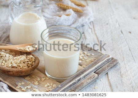 oat milk and rolled oats stock photo © nito