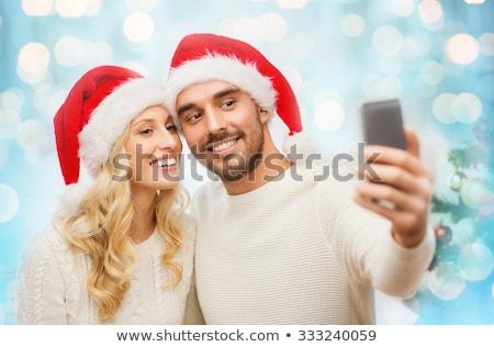幸せ · 若い女性 · ポーズ · クリスマス · 携帯電話 · 赤 - ストックフォト © dolgachov