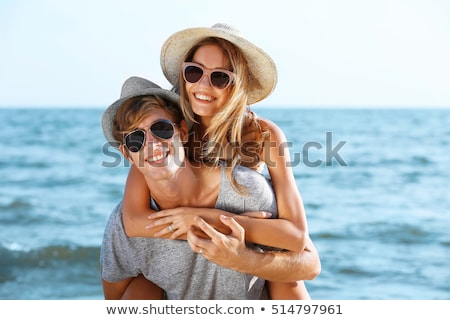 Happy beach vacation woman in hat and sunglasses stock photo © Maridav