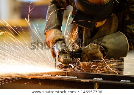 Stock photo: Worker working on metal with grinder tool