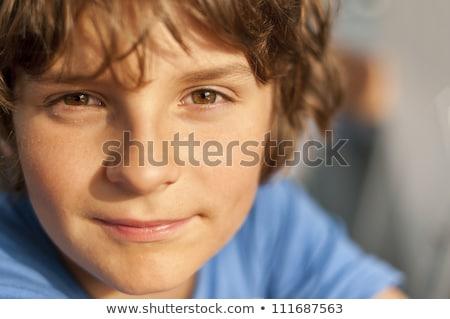 Boldog fiatal srác barna szemek mosolyog mosoly gyerekek Stock fotó © meinzahn