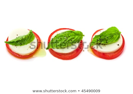 Arrangement of mozzarella and tomatoes.  Stock photo © fanfo