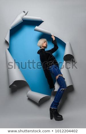 Femme jeans short isolé blanche Photo stock © Elnur