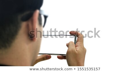 focused asian man using blank screen mobile phone and computer stock photo © deandrobot