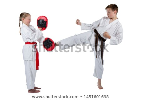 A male and a female doing martial arts Stock photo © bluering