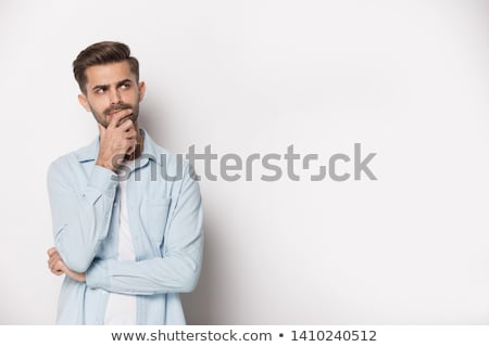 Pensive adult unshaven man with hand on chin Stock photo © stevanovicigor