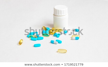 синий капсулы вокруг желтый таблетки белый Сток-фото © viperfzk