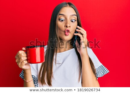 Grimacing woman gesturing to cup of coffee Stock photo © ozgur